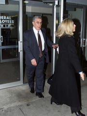 Anthony Spero leaves Federal District Court accompanied by an unidentified woman, in Brooklyn, New York on March 7, 2001.