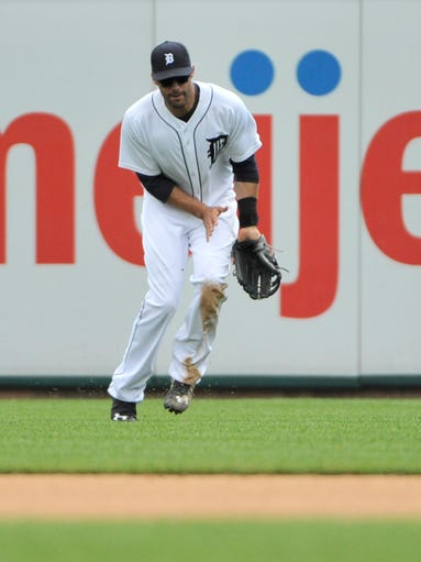 Tigers right fielder J.D. Martinez is given an error