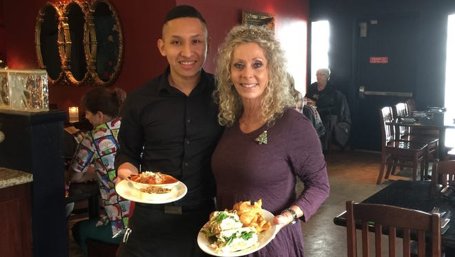 Owner Karline Niver, right, with server Abraham Rios during lunch at Gironda's in downtown Redding.