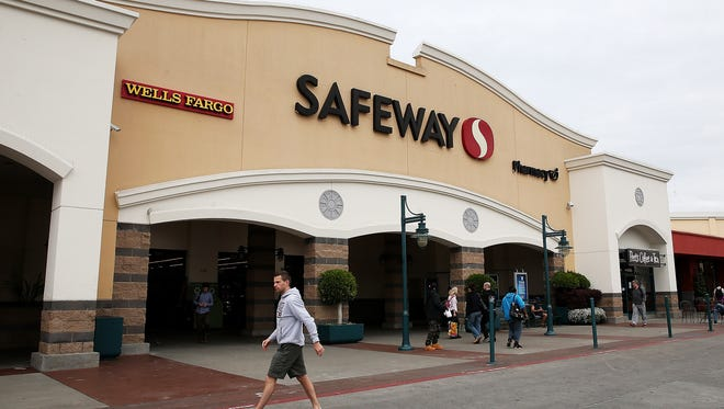Customers leave a Safeway store on in San Francisco, California.