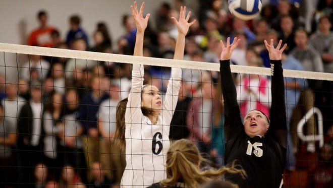 Lee's Jennifer Williams prepares a block as Buffalo Gap's Camille Ashby sets the ball during the 2A girls volleyball championship at R.E. Lee High School in Staunton on Saturday Nov. 12, 2016.