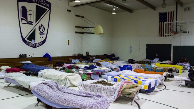 Cots wait to be filled at overflow shelter at the former Northview Elementary School, 1721 Northview Road in Waukesha in this 2014 file photo. Two local organizations announced the old school will once again be used as a shelter.