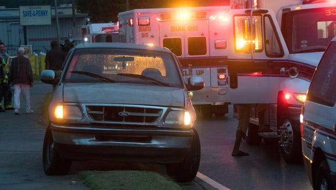 First responders on the scene of an accident involving two pedestrians and a motor vehicle on W Street Thursday, Nov. 2, 2017.