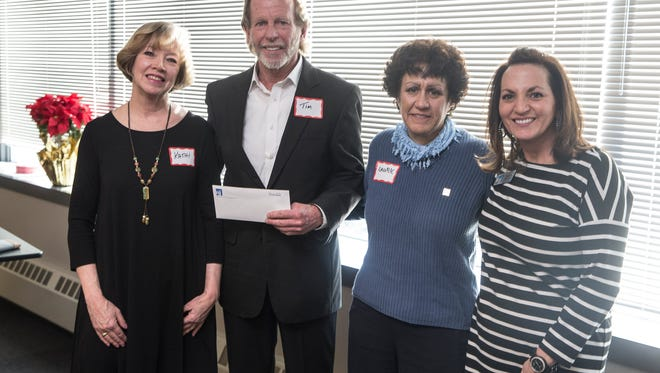 Nine local nonprofits on Tuesday received checks from the Gannett Foundation, which supports nonprofits in the areas covered by Gannett publications. Kathi Abatemarco, left, and Karen Guarasi, right, of GannettNJ present a check to Tim Zeiss and Laurie Salka of the Brookdale Foundation.      