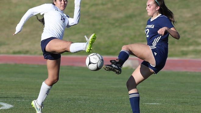Marci Gallo (left) picked up two goals as the La Quinta girls' soccer team won its playoff road game on Friday.