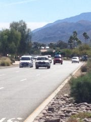 Traffic flows on Gene Autry Trail adjacent to Palm