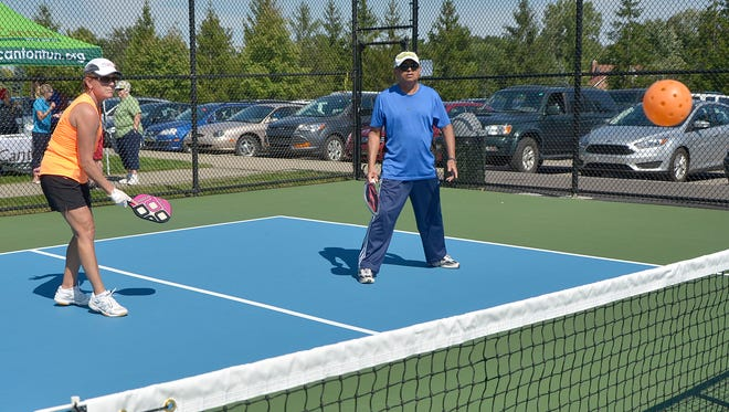 Jane Bersuder and Nawa Quaraishi play on the new pickleball courts in Canton Township's Freedom Park.