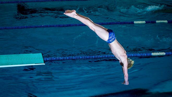 Delta's Sam Bennett practices for the diving state championships at Delta High School Wednesday, Feb. 21, 2018.