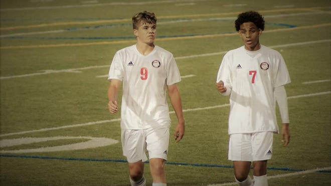 Emanuel Small, right, is the current captain for Palm Beach Central High boys soccer team.