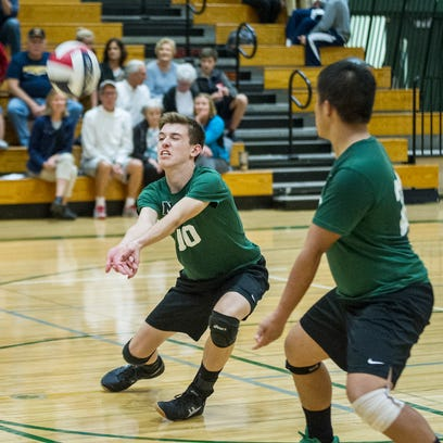 Isaac Lawson of Nathan Hale takes a lunge to return a serve against Marquette high school. 19 Oct 2016