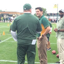 U.S. Speaker of the House Paul Ryan speaks with Packers coach Mike McCarthy during training camp practice.