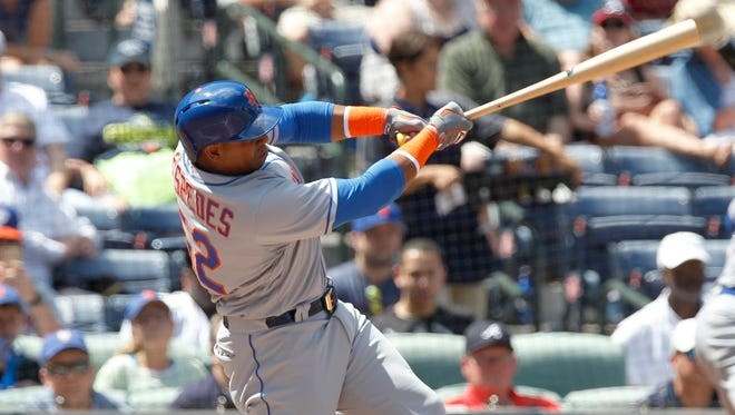 New York Mets batter Yoenis Cespedes hits a grand slam home run off of Atlanta Braves pitcher Williams Perez, not seen, in the third inning of a baseball game in Atlanta Sunday, Sept. 11, 2016.