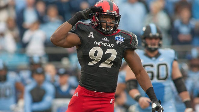 Bearcats defensive lineman Silverberry Mouhon celebrates after sacking the quarterback during the Belk Bowl against North Carolina in December of 2013.