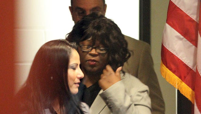 Shawntrell Dawkins, center, walks in the courtroom during her 2013 murder trial in the death of Milanya Harris, 2, before 409th District Court Judge Sam Medrano Jr.