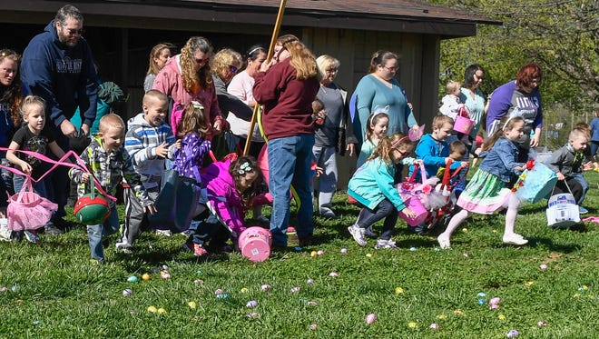 """And they're off"" as the 5-6 year olds start their egg hunt at the Henderson city's Parks and Recreation Department's annual Easter egg hunt held at Community Park Saturday, April 8, 2017."