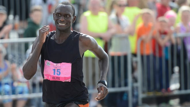 Joseph Amenya of Grand Junction, Texas, eyes the finish line as he finishes first in the marathon in 2 hours, 19 minutes, 38 seconds at the Cellcom Green Bay Marathon on Sunday, May 17, 2015.