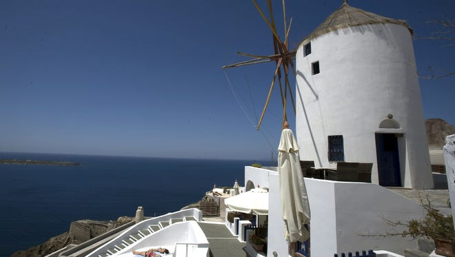 The Greek islands, including Santorini, are Lonely Planet's top pick for value travel in 2014.