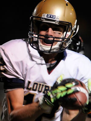 Our Lady of Lourdes High School's Luke Timm catches a pass during the state playoffs against Marlboro last season.
