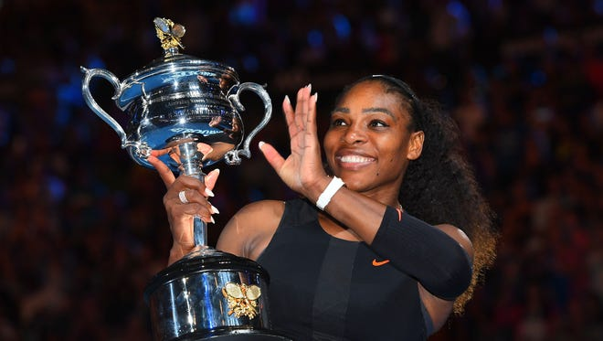 Serena Williams poses with the Daphne Akhurst Trophy after winning the women's singles final against Venus Williams during the Australian Open on Jan. 28.