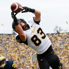 Appalachian State Mountaineers wide receiver Simms McElfresh (83) makes a touchdown catch in the third quarter against the Michigan Wolverines at Michigan Stadium.