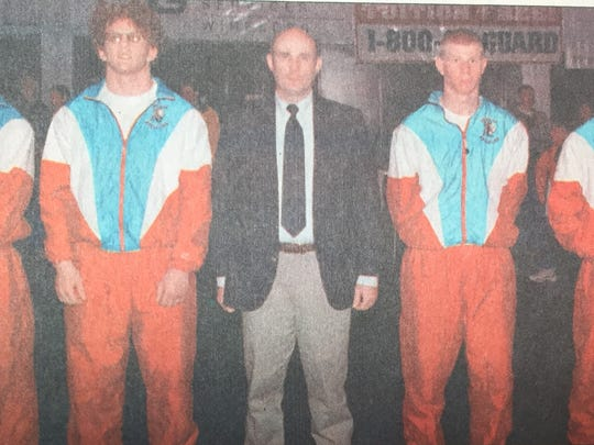 Union County Head Wrestling coach Dennis Walls is flanked by four of his top wrestlers. From left are George King, Clint Hayes, Derek Trowbridge, and Josh Walls. Trowbridge placed second, while the others placed third in their respective weight classes in the state wrestling finals in February 1999.