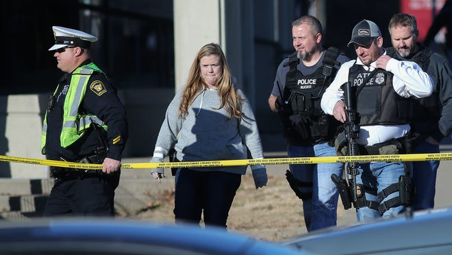 Police respond to an active shooting situation at UC Health Pyschiatric Emergency Services unit, striking an unarmed security officer, Wednesday, Dec. 20, 2017.