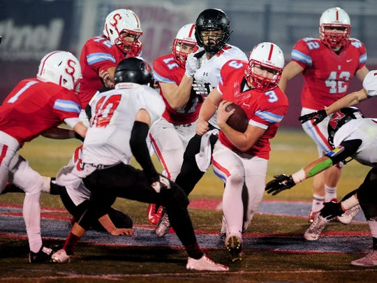 South Salem quarterback Gabe Matthews (3) carries the ball against North Medford during the first round of the 6A state playoffs, Friday, November 6, 2015, at South Salem High School in Salem, Ore. South Salem won the game 21-20.