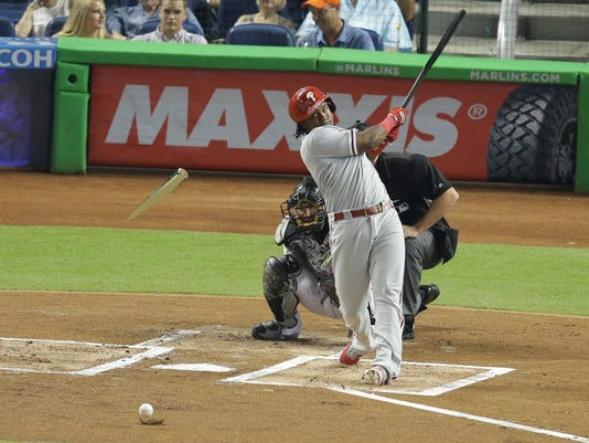Philadelphia Phillies' Maikel Franco breaks his bat on a ground-out during the first inning of a baseball game against the Miami Marlins, Tuesday, July 26, 2016, in Miami. (AP Photo/Lynne Sladky)
