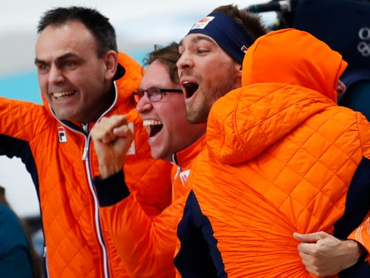 Gold medallist Kjeld Nuis of The Netherlands, second right, celebrates with his team after the men's 1,500 meters speedskating race at the Gangneung Oval at the 2018 Winter Olympics in Gangneung, South Korea, Tuesday, Feb. 13, 2018. (AP Photo/Petr David Josek)