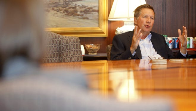 Ohio Gov. John Kasich talks with members of the Enquirer editorial board on Monday afternoon.