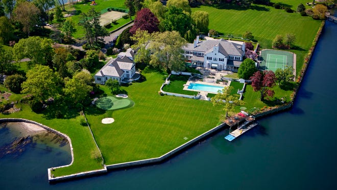 Donald Trump's former Greenwich mansion sits on its own 6-acre peninsula, surrounded on three sides by the waters of Long Island Sound.