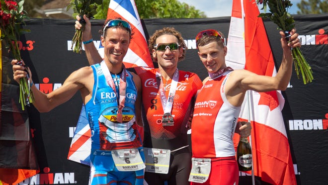 Tim Don, Andreas Raelert and Brent McMahon share the podium as the top three finishers of the St. George Ironman Saturday, May 2, 2015.