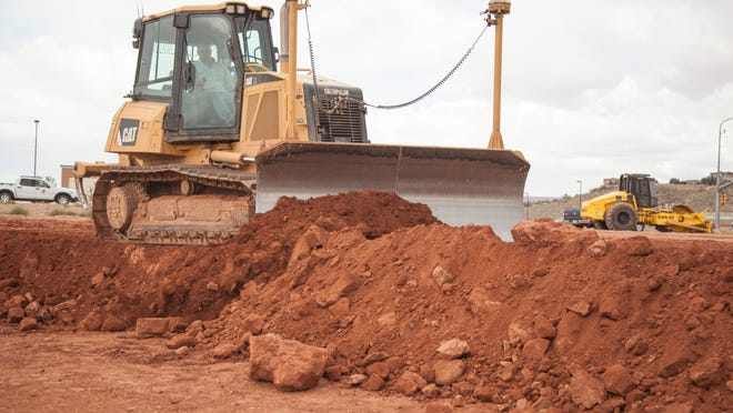 Crews begin work on the land near River Road and 1450 South in preparation for Boulder Creek Crossing, a future retail and commercial center Thursday, May 7, 2015.