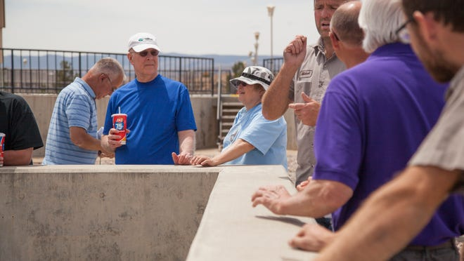 City employees at the St. George Regional Wastewater Treatment Plant explain the various functions of the plant to local residents during a Water Week tour Wednesday, May 6, 2015.