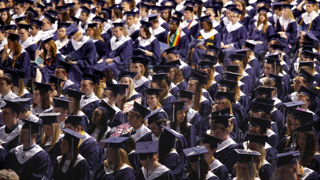 The crowd at Xavier University's 2013 commencement was full of smiling faces. Anthony Munoz, former Bengals star, was the speaker and received an honor doctor of humanities degree.