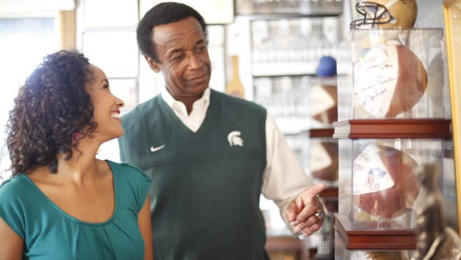 "Filmmaker and actress Maya Washington, left, and her father, former MSU football great Gene Washington, worked together on a documentary titled, ""Through the Banks of the Red Cedar."" It is about MSU in the 1960s, coach Duffy Daugherty's role in desegregating college football and the Spartans' parallel in recent years under Mark Dantonio."