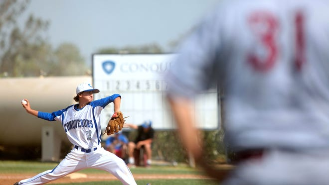 Scott Jones, pitches for the Conquerors at a CIF division six match against Saint Margaret's High Schooll in Bermuda Dunes on Friday.