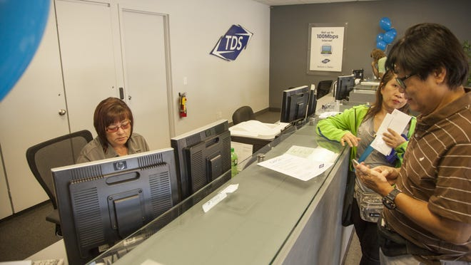 Employees of the new TDS location hold an open house to connect with the St. George community Saturday, June 13, 2015.