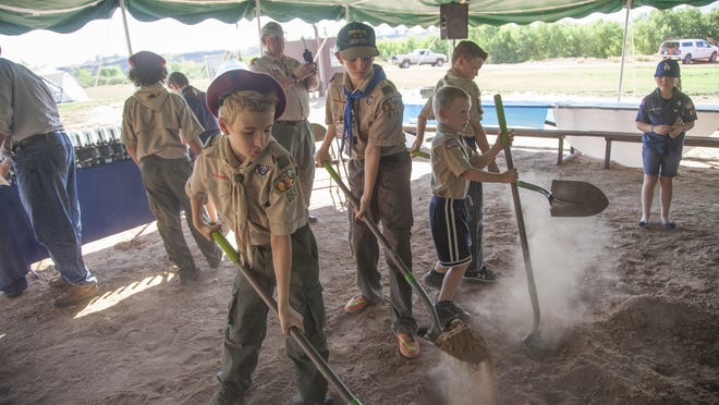 Members of the Boy Scout community break ground at the Marion D. Hanks Scout Camp at Quail Creek Friday, June 26, 2015.