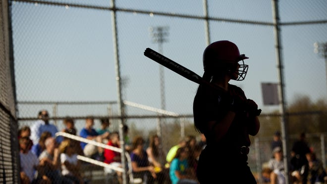 A Port Huron player stands on deck during a softball game Thursday, May 7, 2015 at Marysville High School.