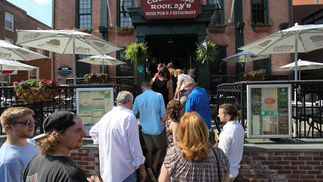 Downtown Newark Food and Brew Fest patrons wait to enter Catherine Rooney's.
