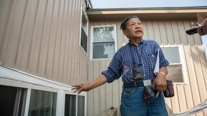 Burlington landlord Soon Kwon points to one of 25 housing code violations housing inspectors have listed at his 40-42 Colchester Ave. property.