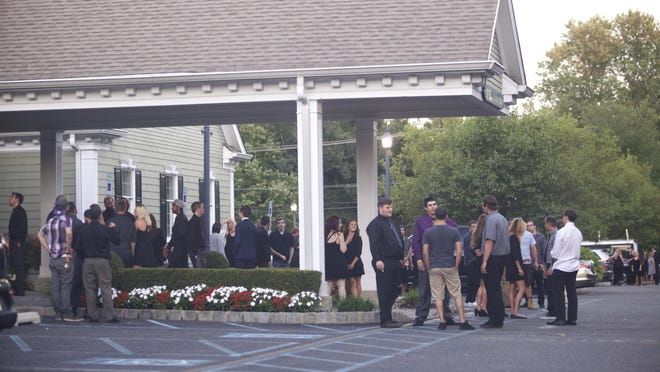 Mourners gather outside O'Brien Funeral Home in Brick Thursday for the wake of Julian Hoffman.
