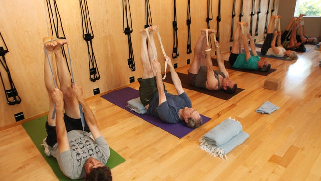From left, Joe Kirkland, Michael Scudder, Michael Curran and Eduardo Torres participate in an Iyengar yoga class at Clear Yoga in Rhinebeck July 22.