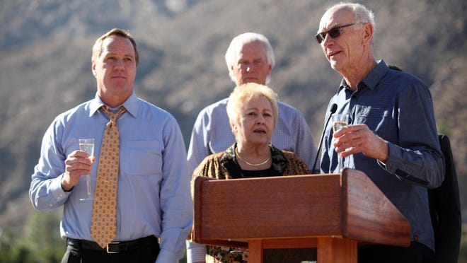 John Wessman, right, participates in the groundbreaking ceremony for the Desert Fashion Plaza project on Jan. 16, 2014, in Palm Springs with Mayor Steve Pougnet, left, and City Council member Ginny Foat, front.