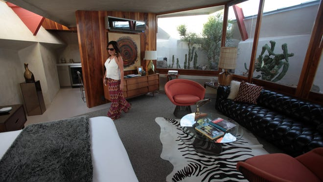 """Owner Tracy Beckmann shows off the rooms she restored at Hotel Lautner in Desert Hot Springs in 2014. Modernism fan Kurt Cyr said will lead a """"Martini Madness"""" cocktail event at Hotel Lautner on Friday that shares the history of the libation and how it came to be known as the """"king of cocktails."""""""