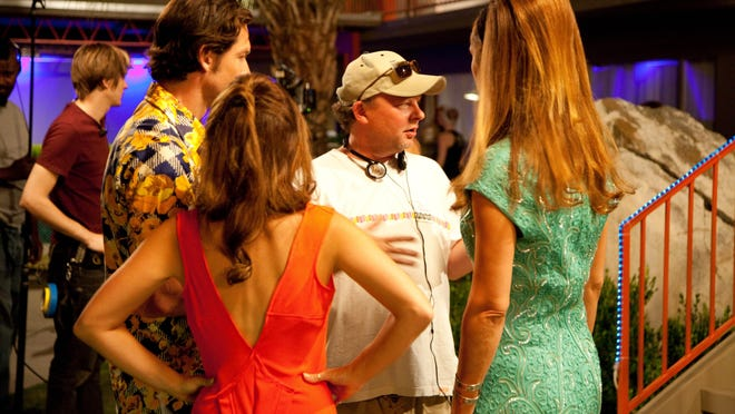 """""""Palm Swings"""" director Sean Hoessli, wearing a hat, interacts with the cast during a shoot at Skylark Hotel in Palm Springs."""