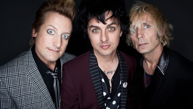 Musicians Tre Cool, Billie Joe Armstrong and Mike Dirnt of Green Day.  Photo by Felisha Tolentino [Via MerlinFTP Drop]