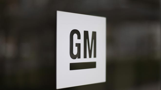 This May 16, 2014, file photo, shows the General Motors logo at the company's world headquarters in Detroit.
