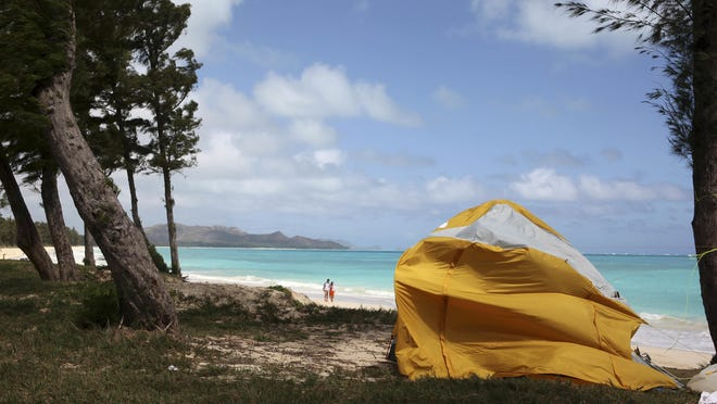 A tent sits on Waimanalo Beach, one of Hawaii's world-class beaches. State lawmakers are considering a bill to crack down on a growing market: vacation rental brokers who offer up tents to tourists on beaches and in public parks.